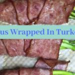 "Picture of Asparagus wrap with Turkey Bacon and the words ""Asparagus Wrapped In Turkey Bacon"" 