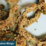 Almond crusted gluten free onion rings on a white plate | Root Nutrition Education and Counseling
