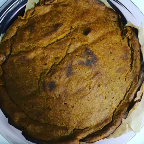A baked gluten free dairy free cashew cream pumpkin pie in a pie dish | Root Nutrition and Education