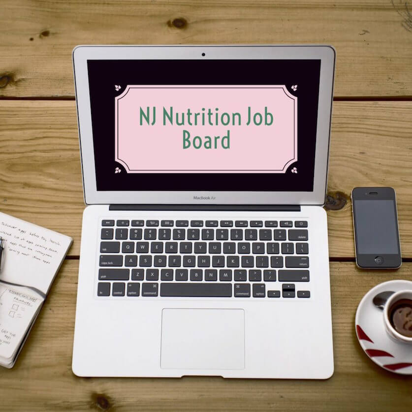 "Mac Laptop with the words ""NJ Nutrition Job Board"" in a pink box on a black screen 