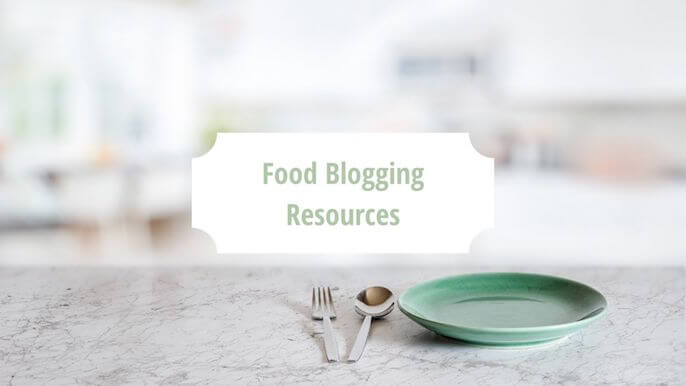 """A kitchen counter with a Green Plate with fork and knife and words """"food blogging resources"""" in green against a white block 